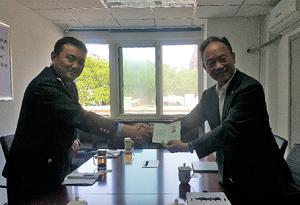 欣欣北京代表处丁永庆先生获颁首席代表证书